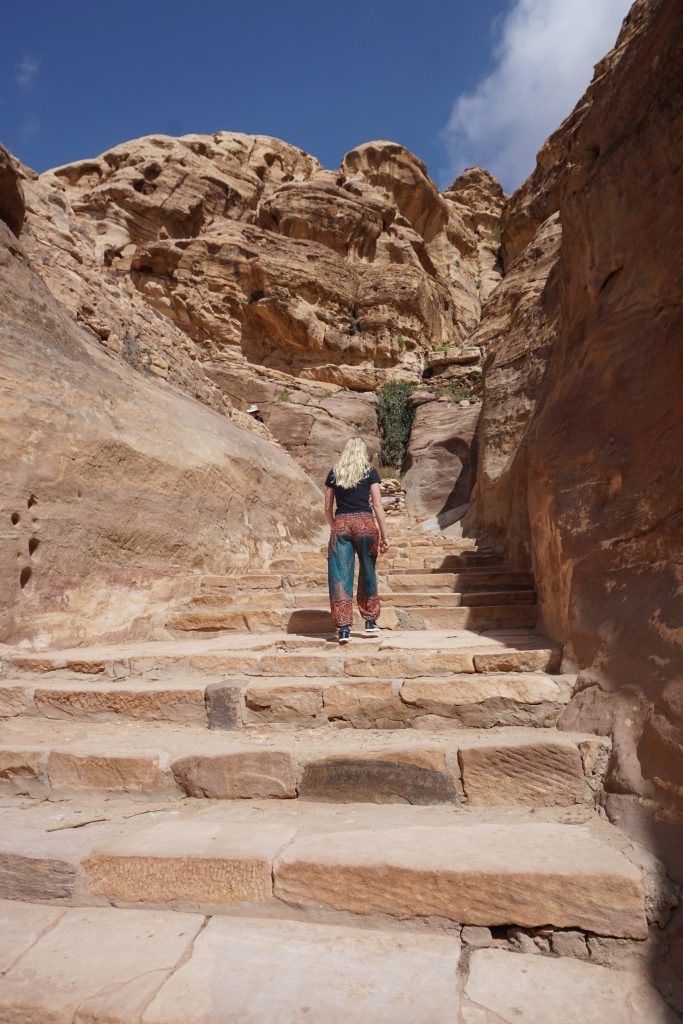 climbing up to the Monastery in Petra, Jordan
