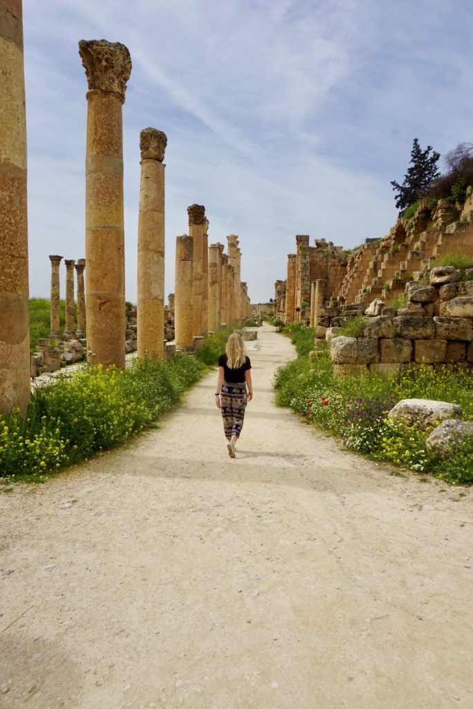 wandering away from the camera amidst the ruins of Jerash, Jordan