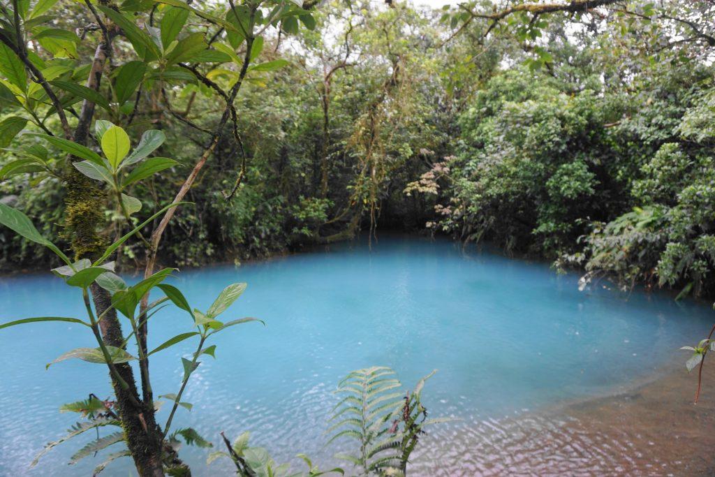 blue and brown water meet in Laguna Azul